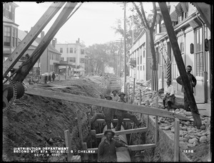 Distribution Department, Low Service Pipe Lines, Section 8, trench in Second Street, station 146+, from the south, Chelsea, Mass., Sep. 9, 1897