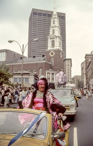 Female impersonator at gay pride parade, Tremont Street, note Park Street Church, Boston
