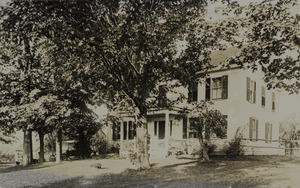 House with model T Ford in driveway