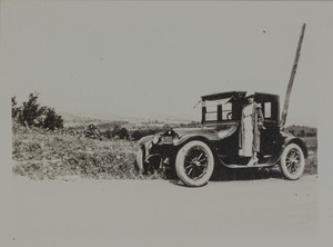 Unidentified woman with car, 121