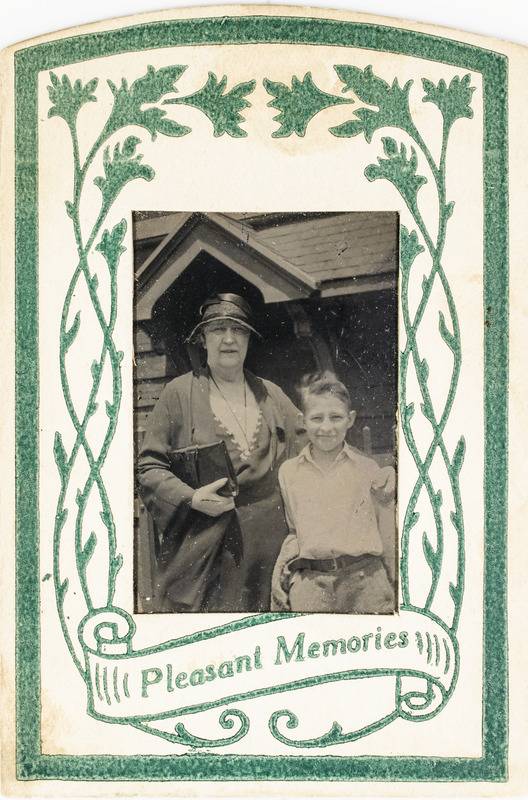 """Unidentified woman and boy with """"Pleasant Memories"""" frame, 120"""