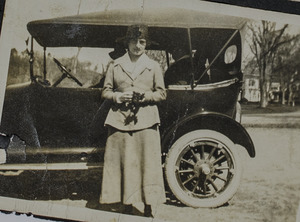 Unidentified woman with car, 099