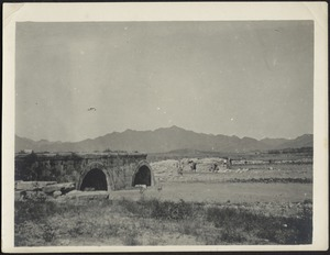 Ancient stone bridge in ruins on road to Ming Gunho (sp?)