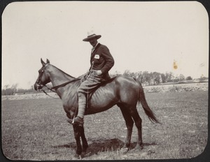 Man with wide-brimmed hat on horse; possibly cavalry officer or Rough Rider