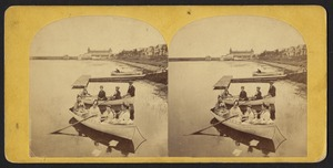 Seven women and a man seated in two rowboats, with a man in a third rowboat in the midground