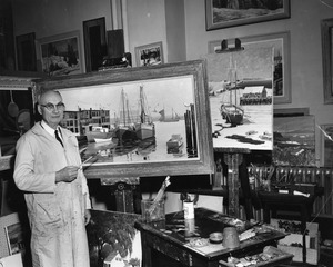 President Maurice Lindsay with his paintings