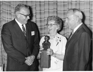 Bertha Stratton accepts award for Harry Bentley at 50th Anniversary