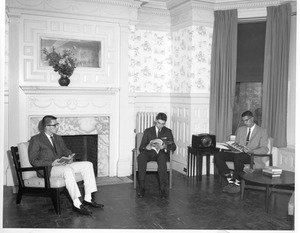 Students in common room of dormitory at 373 Commonwealth Avenue on Boston campus