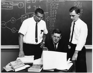 Professor Ed Wondolowski with students studying early automatic computers