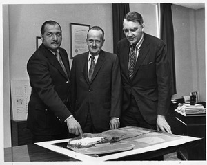 President Gregory Adamian with Robert Weafer and [?] surveying model of Athletic facilities and grounds