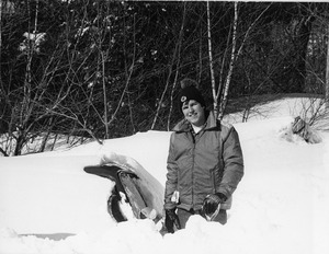 Student poses near car buried in snow during Blizzard of '78