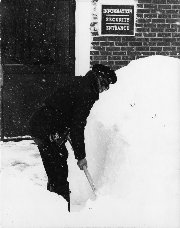 Member of Campus Police shovels snow during Blizzard of '78