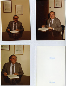 President Gregory Adamian reading papers in his office