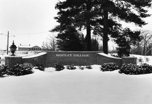 Bentley College sign on campus road