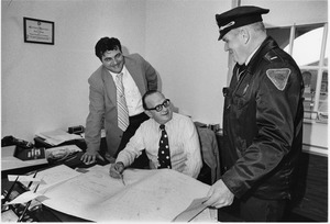 Campus Police and Bob Weafer surveying blueprints
