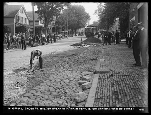 Distribution Department, Northern High Service Pipe Lines, break in 30-inch main in Cross Street, from Main Street; general view of street, Malden, Mass., Sep. 15, 1918