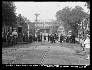 Distribution Department, Northern High Service Pipe Lines, break in 30-inch main in Cross Street, looking towards Main Street; general view of street, Malden, Mass., Sep. 15, 1918