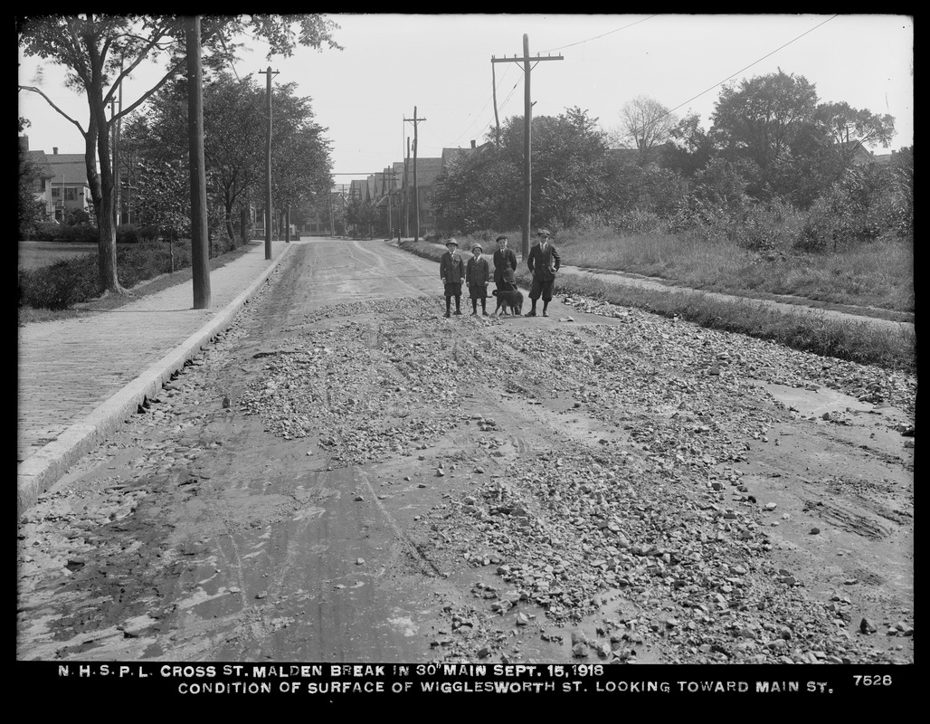 Distribution Department, Northern High Service Pipe Lines, break in 30-inch main in Cross Street; condition of surface of Wigglesworth Street, looking towards Main Street, Malden, Mass., Sep. 15, 1918