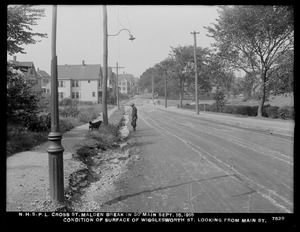 Distribution Department, Northern High Service Pipe Lines, break in 30-inch main in Cross Street; condition of surface of Wigglesworth Street, looking from Main Street, Malden, Mass., Sep. 15, 1918