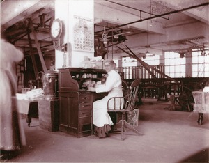 Woman at desk, B. and R. Rubber Co., North Brookfield, May, 1912