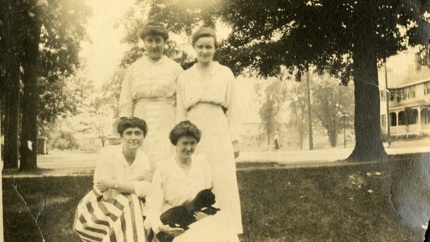 Librarians of the Jacob Edwards Library with cat in Southbridge Massachusetts