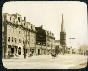 Main Street north side from Masonic block looking east including a horse drawn vehicle and street railway Southbridge Massachusetts