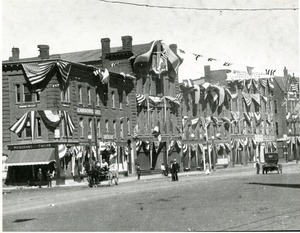 South side of Main Street en fete July 1916: streetscape Southbridge Massachusetts