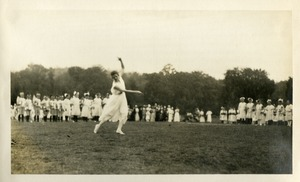 Woman in motion with children at Wellsworth Field Southbridge Massachusetts during the Centennial Celebrations
