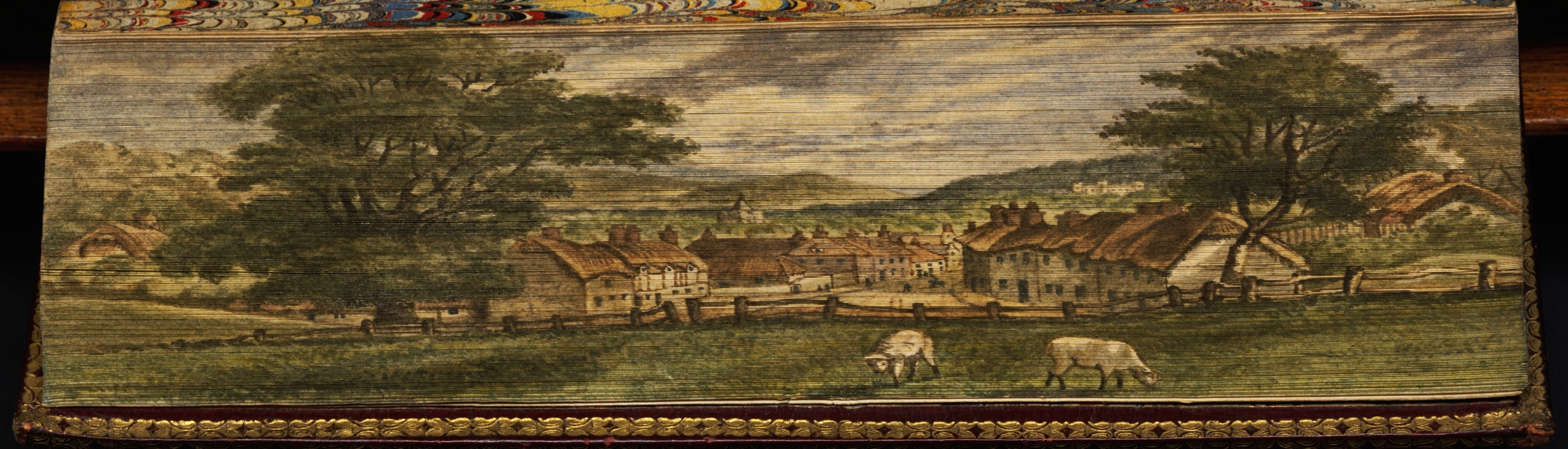 Winborne, Dorset, the birthplace of Matthew Prior, showing houses and cattle