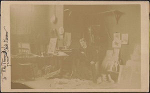 Photograph of the artist Childe Hassam in his studio