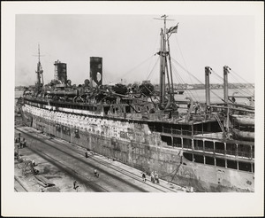 AP-21 USS WAKEFIELD-Arrival at US Naval Drydock after fire at sea