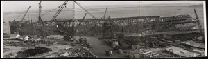 AP-21 USS WAKEFIELD-Being stripped of fire damage at US Naval Drydock in early 1943