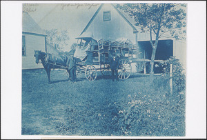 Alfred Taylor, left, and Daniel Taylor, right, with cartload of chairs