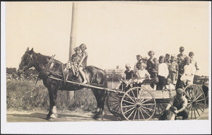 Doris Schirmer on horseback with Mr. Tripp and group of children