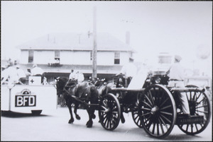 Antique fire engine in parade passing by Hyannis Depot