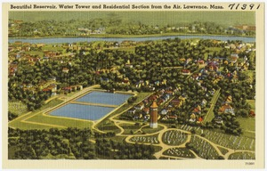 Beautiful reservoir, water tower and residential section form the air, Lawrence, Mass.