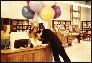 Newton Free Library, Newton, MA. Staff & trustees. D. Seavey with balloons
