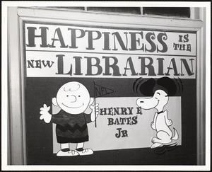 """Newton Free Library, Newton, MA. Staff & trustees. Sign """"Happiness is the new librarian, Henry Bates"""""""