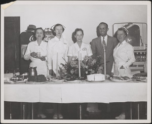 Staff at Veterans Administration Hospital behind banquet table