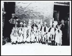 Portuguese 11 young children in costume and two male musicians, location unknown