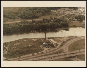 Aerial view of a smokestack and river