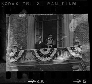 Unidentified uniformed man speaking from balcony of the Old State House