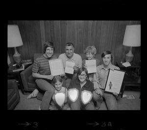 The Abruzzese family holding the many expressions of appreciation presented by President Nixon, J. Edgar Hoover, police and civic groups. From left: Thomas, 15, Rocco Abruzzese and wife Rosemary, David, 18, Mary Ellen, 7, and Susan 13