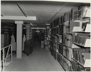 Books on shelves, Boston Public Library Johnson building construction, July 1972