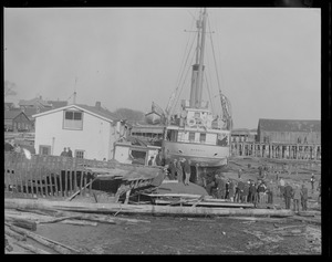 USS Merrill washed ashore in storm against pier at Provincetown, Mass