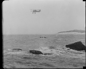 Aeroplane flying over capsized life-saving boat off Manomet Point