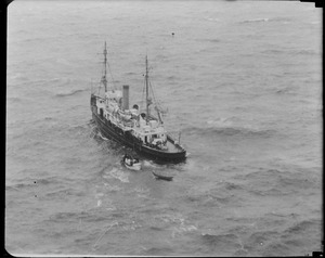 USCG ship Redwing taking care of passengers on SS Robert E. Lee high on Mary Ann Ledge