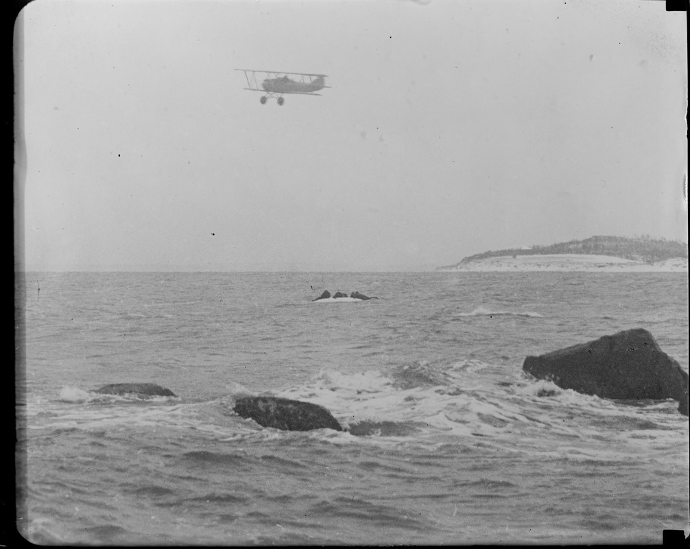 Aeroplane flying over capsized boat of the Manomet life saving crew during SS Robert E. Lee rescue