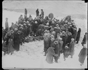 Working on one of the Manomet life saving crew after he fell into icy water during SS Robert E. Lee rescue. The man died.