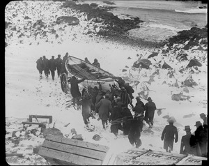 Manomet life saving crew carting surf boat to the water. Three of eight died when the boat capsized while returning from the SS Robert E. Lee.